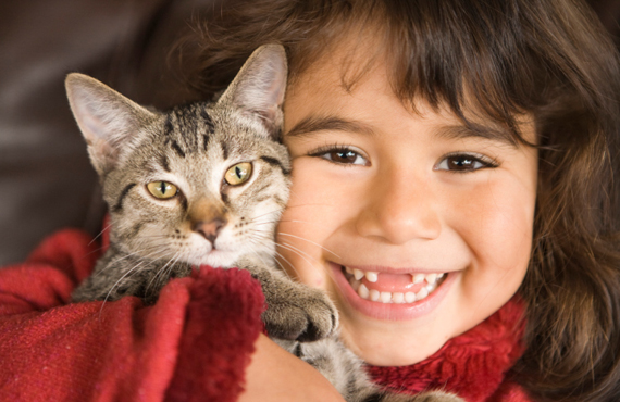 Young girl with gray cat