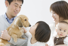 A family with a small dog
