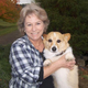 Veterinarian Joann M. Voss and a dog outside at a park